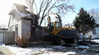 Wide angle view of house being demolished