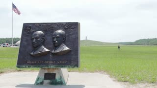 Wilbur and Orville Wright Plaque in front of field