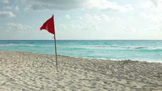 Windy beach weather with red warning flag out