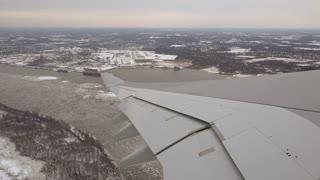 Wing view flying over snow covered Philadelphia 4k