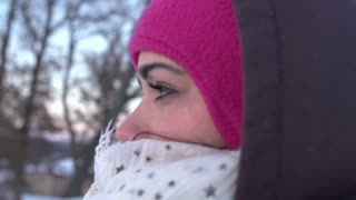 Woman bundled for cold weather looking into distance