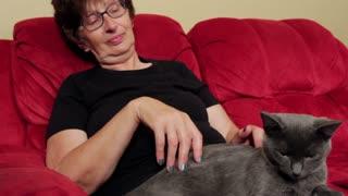 Woman enjoying company of cat