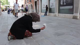 Woman in streets of Venice asking for money
