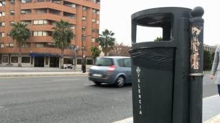 Woman throwing away item on public street of Valencia Spain 4k