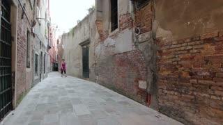 Woman walking towards camera in Italy street
