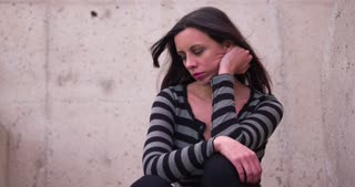 Worried and upset woman sitting 4k