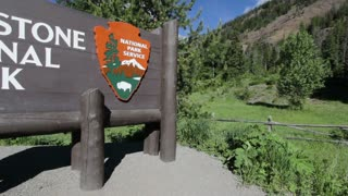 Yellowstone National Park Sign pan shot
