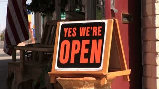Yes we are open sign in front of American business