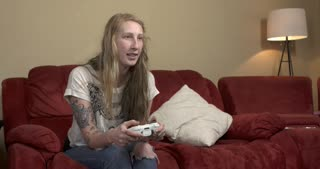 Young alternative girl with tattoos playing Xbox 360 quits and gets upset 4k