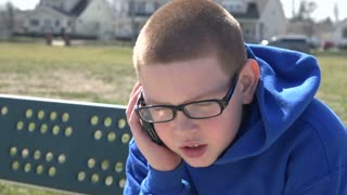 Young boy talking on cell phone