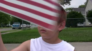 Young Boy waving american Flag
