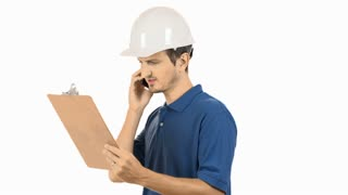 Young construction worker on cell phone