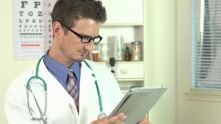 Young doctor using tablet in office