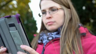 Young female reading on her tablet pan shot 4k