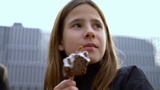 Young girl eating an ice cream 4k