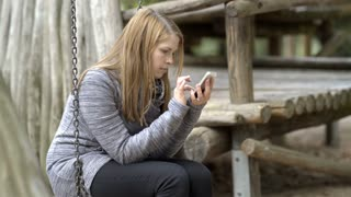 Young girl having fun playing game on cell phone 4k