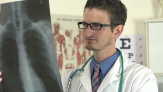Young male doctor review xray