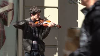 Young man playing violin in downtown Boston