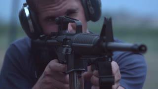 Young man shooting AR15 at range