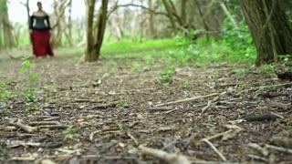 Young renaissance girl walking through woods barefoot 4k