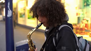 Young street entertainer playing saxophone in Frankfurt Germany 4k