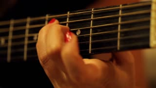 Acoustic black guitar playing