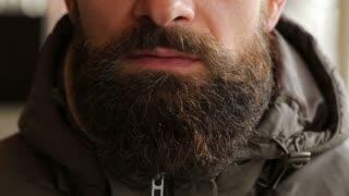 Bearded man smoking electronic cigarette