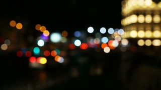 Circular defocused traffic and citylights moving at night from the cars