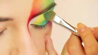 Makeup artist makes a bright eye makeup - stage make-up