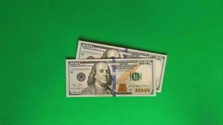 Money dance on green background