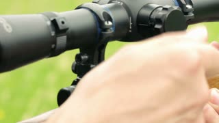 Sniper shoots from a rifle with a sight