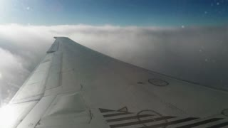 The view from an airplane window - Wing of an airplane flying