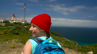 2 in 1 video. Woman with a backpack goes on a picturesque hilly terrain to the ocean
