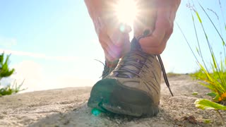 8 in 1 video. Woman is traveling with a backpack over hilly terrain. Hiking