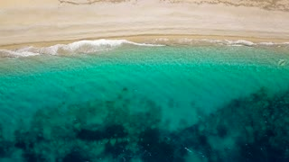 Aerial survey from a drone over the surface of the sea near shore