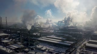 Aerial view of factory smoke stack - Oil refinery, petrochemical or chemical plant in winter