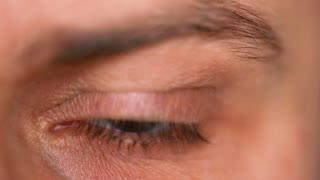 Beautiful blinking male eye close-up
