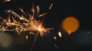 Christmas sparkler burning on a black. Slow motion