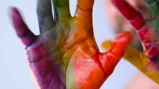 Creative concept - male painted hands cheerfully move his fingers