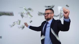 Dollars falling on formally dressed man