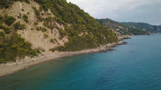 Flight over of coastline at Corfu island in Greece