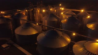 Flight under granaries and elevators or oil storage at night