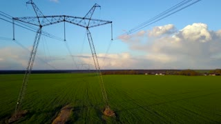 Flying over power line at sunset