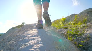 Legs of woman in tourist boots close-up. Hiking