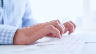 Man office worker typing on the keyboard