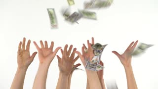 Many hands catch falling US dollars. Slow motion