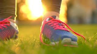 Running shoes - woman tying shoe laces