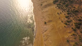 Top view of a deserted beach at sunset. Greek coast of the Ionian Sea