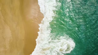 Top view of a deserted beach. The Portuguese coast of the Atlantic Ocean
