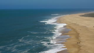 View from the height on a deserted beach. The Portuguese coast of the Atlantic Ocean